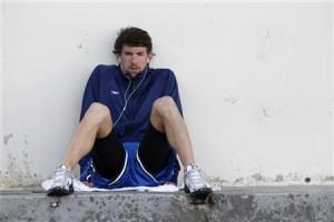 Michael Phelps listens to music at the Santa Clara International Grand Prix swim competition in Santa Clara